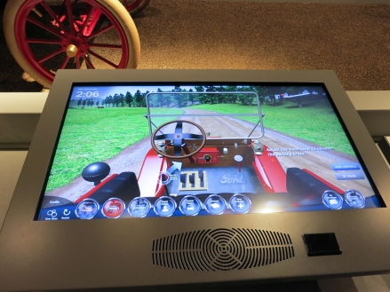 One of several touch-screen interactives designed by Cortina Productions. In this one you learn to drive a Model T and have to navigate around several challenges, including cattle on the road. I led the concept development team for the interactives.
