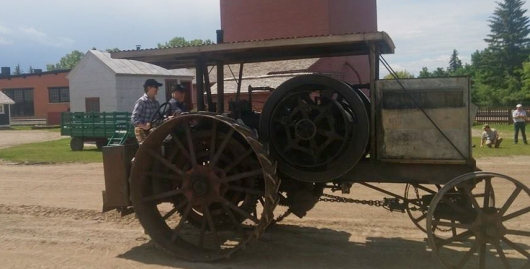 "Me driving a 1911 International Harvester Reliance Model D tractor in an ALHFAM conference competition. It's a single-cylinder, water-cooled engine with a 10"" x 15"" bore and stroke! Yes, that's inches! I didn't win. I hit a cone. Crushed it!"